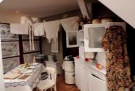 Zdjęcie przedstawia aranżację kuchni z makatkami